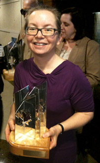 [Carolyn Clink with Aurora Award]